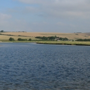The views of the walk in the sunshine, with the lake and fields in the background