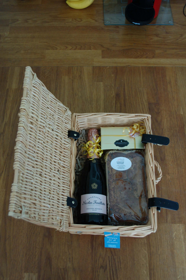 Hamper with Champagne, fruit cake and box of chocolates